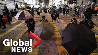 Protesters call on Hong Kong government to abolish anti-mask law