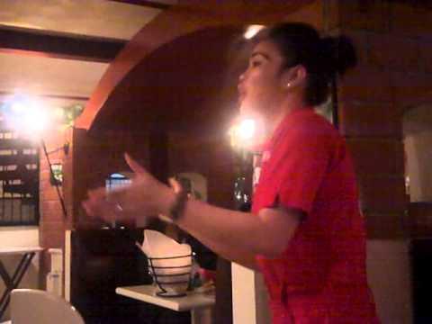 Waitress singing in Italian Job Restaurant in Radison Blu Hotel Doha Qatar