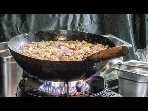 Pad Thai Noodles Cooked at Night Market Warszawa Glowna in Warsaw, Poland. Street Food