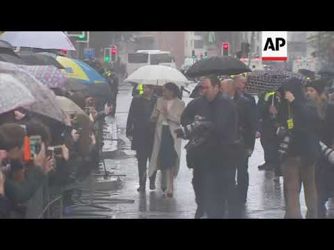 Prince Harry and Meghan Markle do a meet and greet in rainy Belfast