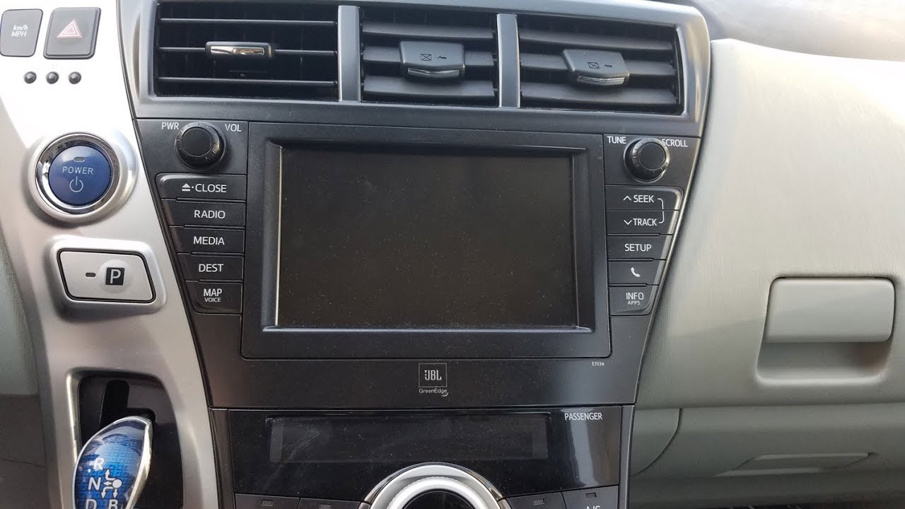 How to Remove Radio / Navigation / Display from Toyota Prius V 2012 for  Repair