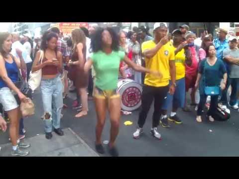 BRAZILIAN GIRLS DANCING STREET SAMBA  AT THE BEATS OF LATIN DRUM BEATS AT BRAZIL DAY NYC 2016