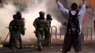 WARNING: GRAPHIC CONTENT - U.S. riot police use tear gas, hit Portland protester with batons