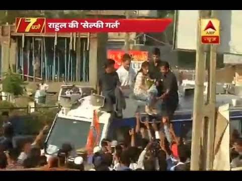 Gujarat Assembly Elections 2017:  A girl climbs Rahul Gandhi's vehicle during his roadshow