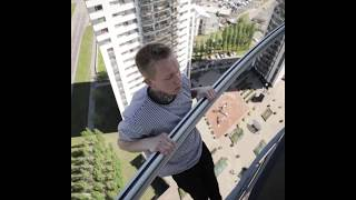 Guy Holding Onto A Rail In The Air With One Hand
