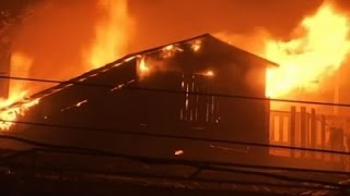Raw: Forest Fire Burns Home on Madeira Islands