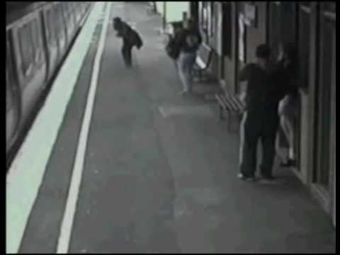 Baby falls on train station track on security camera  Unbelievable clip!!!