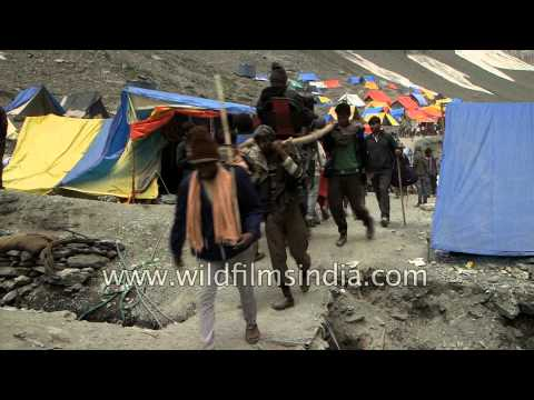 Men carry a Hindu believer into the high Himalaya, for pilgrimage