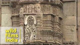 Intricate stone-work on Teen Darwaza facade in Ahmedabad