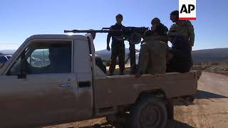 Turkish troops clear two villages in northern Syrian enclave