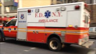 RARE FDNY RESCUE MEDICS AMBULANCE CRUISING BY WEST 48TH STREET IN MIDTOWN, MANHATTAN, NEW YORK CITY.