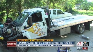 Woman taking action after receiving towing bill