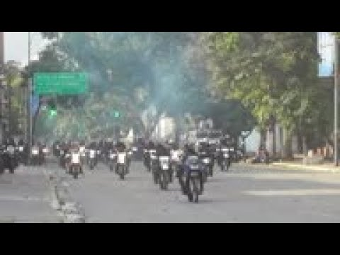 Venezuelan police forces fire buckshots at protesters