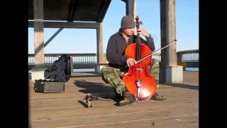 Brandon Smith plays heavy metal cello on a PNW pier