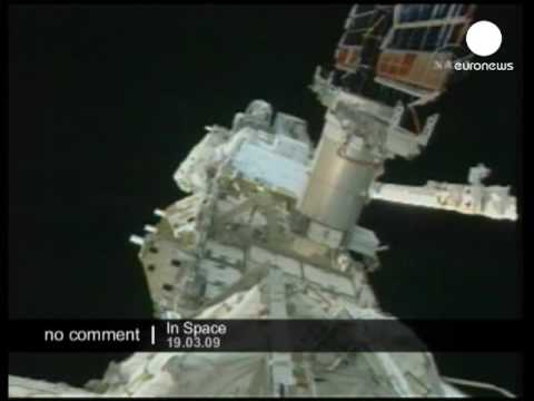 2 astronauts work outside the ISS