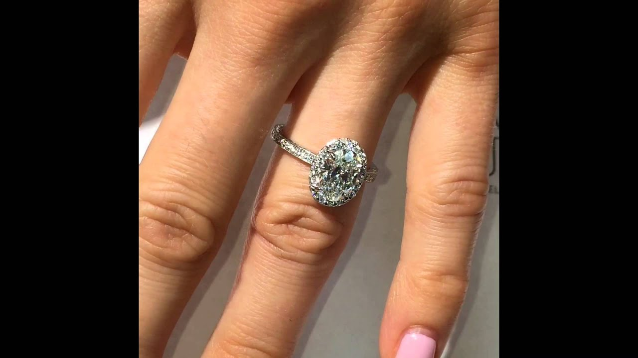 1 50 ct Oval Diamond Engagement Ring in Double Edge Halo