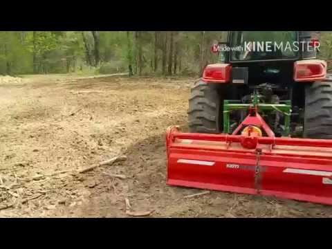 Kioiti NX6010 Tilling deep woods plot, rough, root filled ground