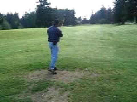 Steve hitting drive at Wellington Hills golfcourse