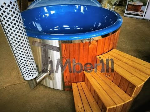 wood burning hot tub with deep blue fiberglass lining timberin