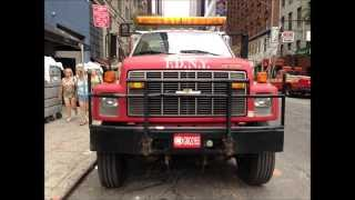 RARELY SEEN FDNY HOOK LIFT ROLL OFF DUMP TRUCK ON W. 49TH ST. & 8TH AVE IN MIDTOWN, MANHATTAN, NYC.