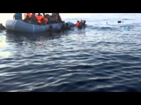 Turkish fishermen rescue migrants whose boat was deflated by Greek coast guard