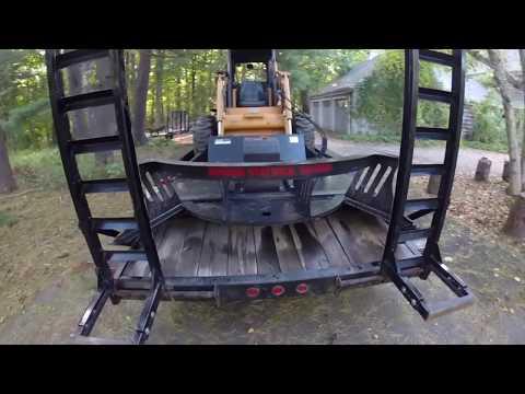 Case 1845c Skidsteer hydraulic brush hog clearing overgrowth