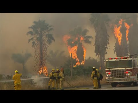 No holiday for crews battling California's largest ever wildfire