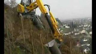 Menzi Muck A91 sideways on a hillside working in a vineyard