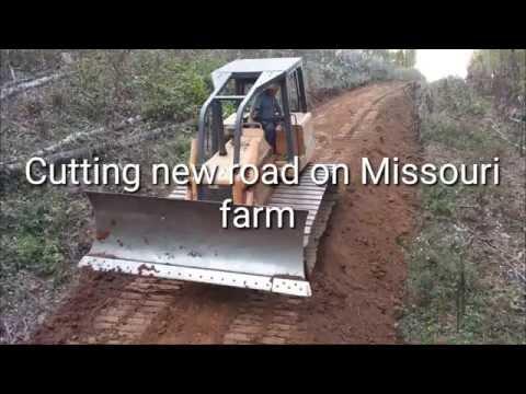 Cutting new road with Bulldozer on Missouri farm