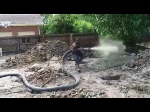 BOOM! He didn't see that coming!! Man gets sent flying by concrete pump blowout