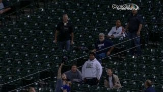 DET@HOU: Fan makes catch with hat, baby in hand