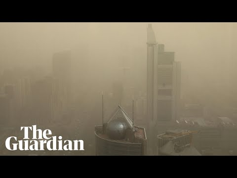 Beijing skies turn yellow as sand and dust engulf Chinese capital