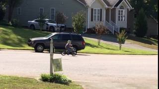 Elliott rides a loop around the culdesac