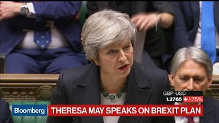 May Defends Brexit Deal Amid Jeers in Parliament