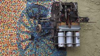 Robotic inventorspray paints gigantic mural using a color printer robot in West Orange