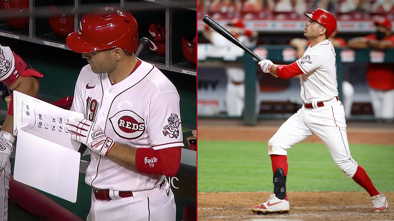 Joey Votto studies his notes, then hits a walk-off