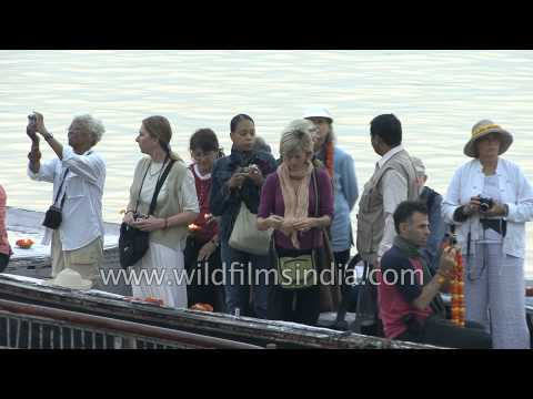 Foreigner tourists take boat ride over Ganga River in Varanasi