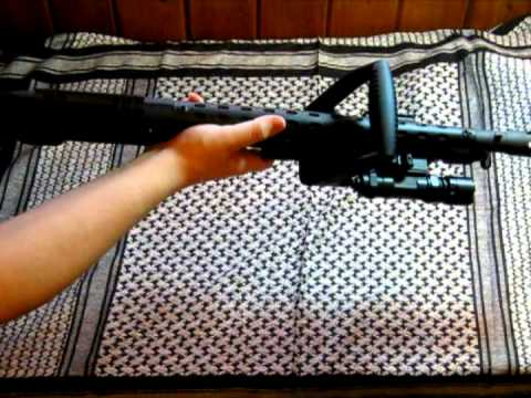 Mossberg 500 chainsaw with accessories
