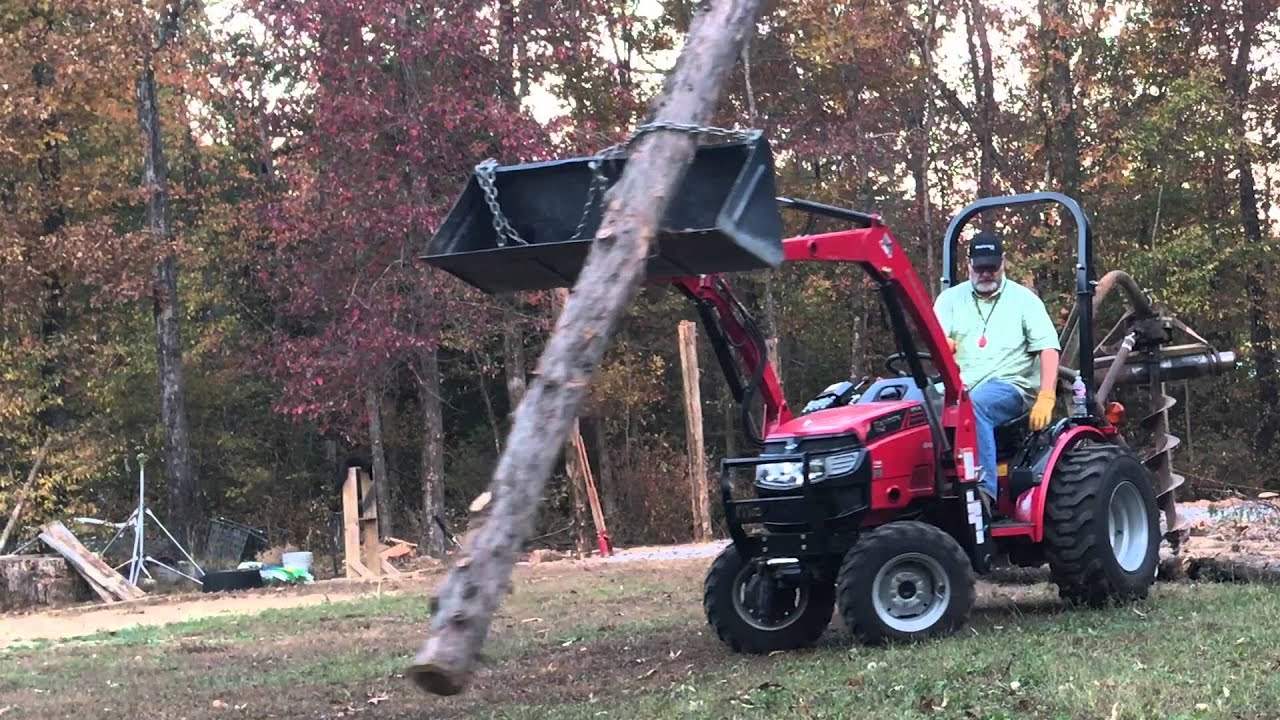 Building my tractor boat pole shed setting a post for How to build a tractor shed