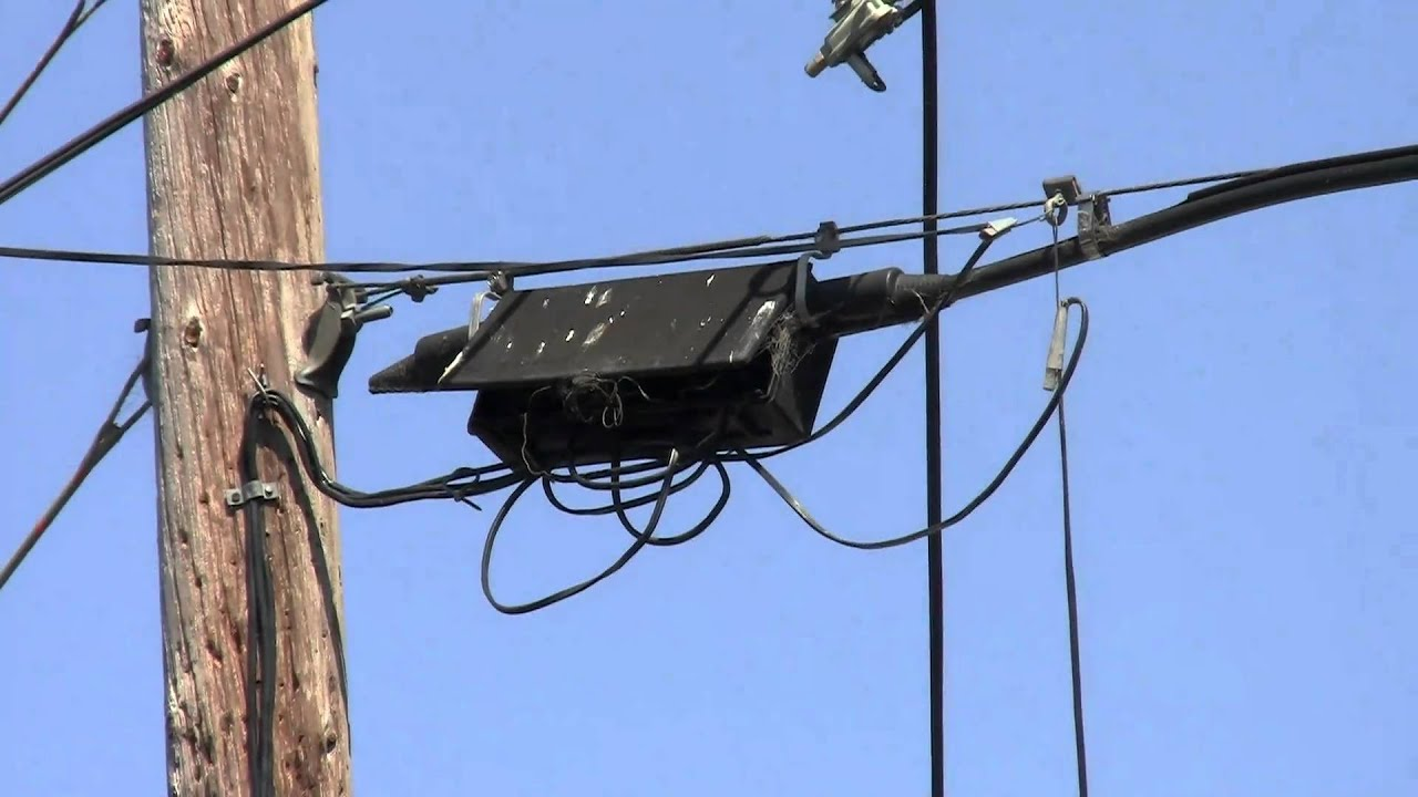 hight resolution of black box and messy wires on a telephone pole