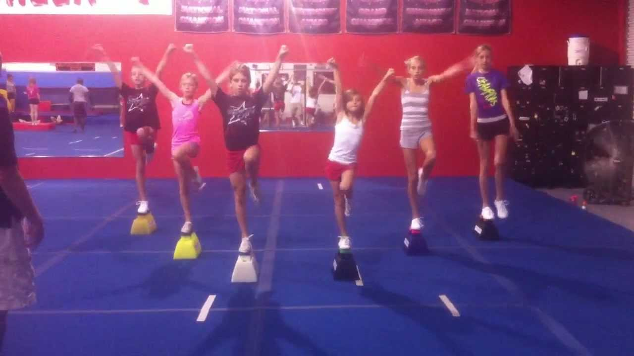 6 flyers practicing liberties on the cheerleading stunt
