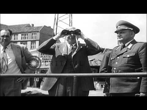 Dr James B Conant walks along a railing and a Soviet soldier checks passes of peo...HD Stock Footage