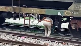 Shocking visuals: People cross railway line by passing under stationary train