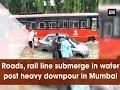 Roads, rail line submerge in water post heavy downpour in Mumbai - Maharashtra News