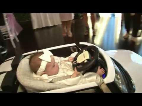 Baby's Grand Entrance in a mini Range Rover