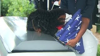 Fallen soldier's widow kisses casket at burial