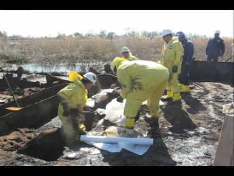 Cleanup crew mops oily barge