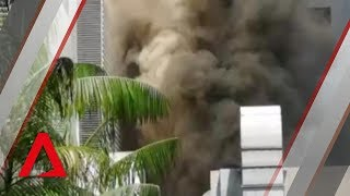 Grand Hyatt fire: Huge plumes of smoke billow out of hotel