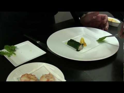 Sarran prepares a dish at his 2 Michelin star restaurant