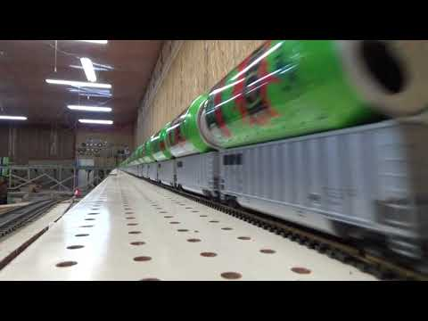The fastest Silver Bullet train with empty 16 oz SURGE cans riding on top of HO scale cars